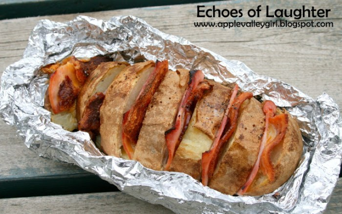 Load up a potato with cheese and ham, wrap in foil, and bake over your campfire!