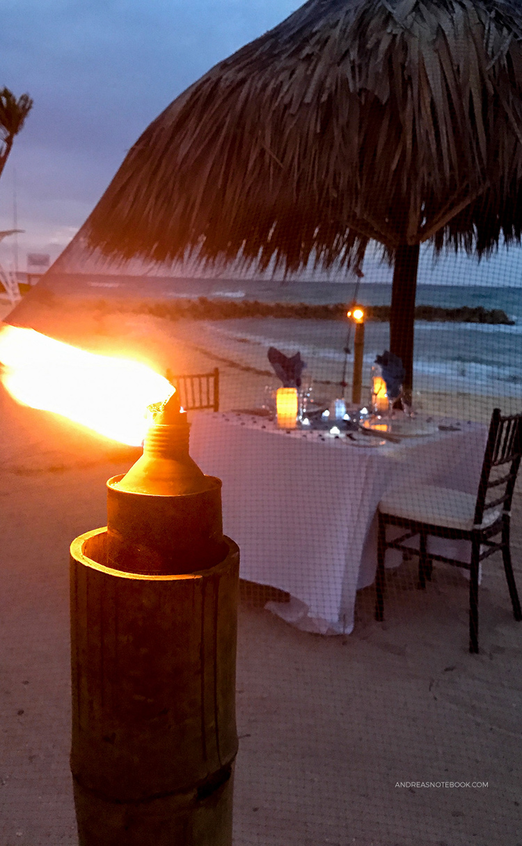 Many all-inclusive resorts have fun activities at night. Take advantage of those! This table was set up under a mosquito net for a private beach dinner.