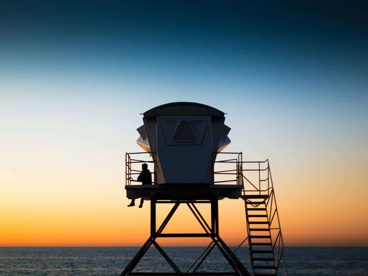 Near beach restaurants this orange and blue sunset with a lifeguard station in silhouette at la jolla cove north of san diego