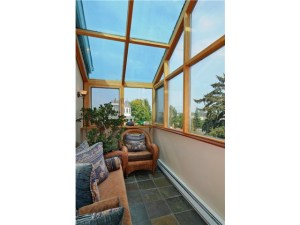 Custom, warm solarium perfect to curl up and read a book or view
