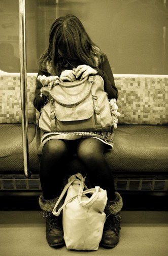 girl travelling by train in Tokyo