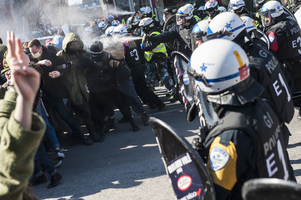 MONTREAL, QUEBEC - APRIL 2 2015: Student protesters get pepper-sprayed on the corner of de Maisonneuve Boulevard and Beaudry Street. The protesters were later tear gassed along Beaudry Street. The protest was the biggest of many, denouncing the Couillard Government's proposed austerity measures and cuts in the educational budget. (The Concordian/Andrej Ivanov) [Winner of the Photo of the Year award at NASH 78] (A couple danced alone in the water during Montreal's own, Coeur de Pirate's, set at the Osheaga Music and Arts Festival 2016. They finished the dance and set with a long dip and then left. The festival drew around 135,000 people over three days. Shot on Ilford Super XP2. (Click for Full Story)