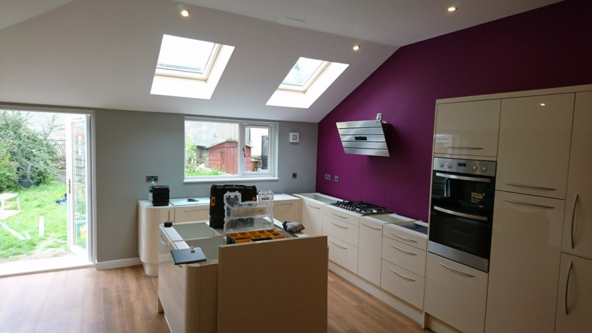 angled roof beams to create open plan kitchen extension