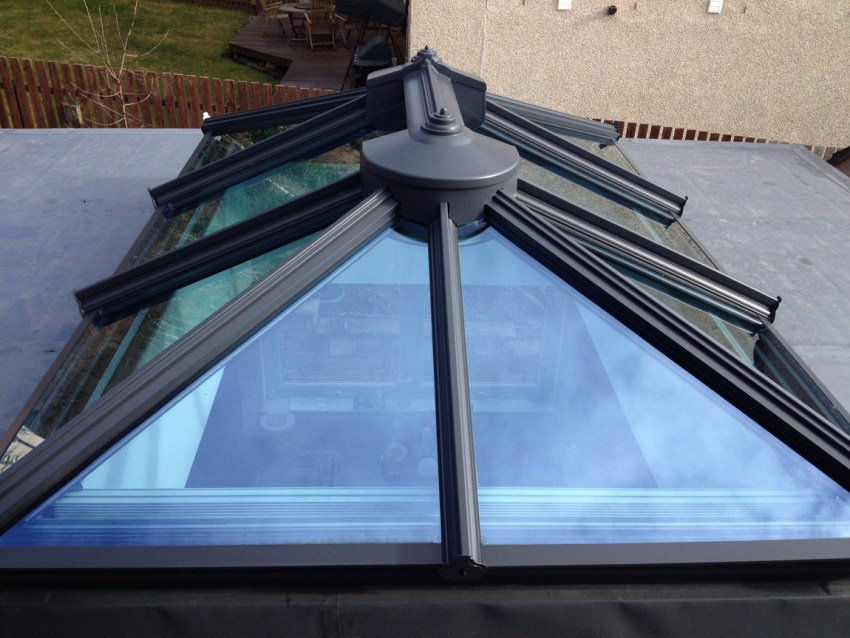 feature glazed cupola roof system over kitchen