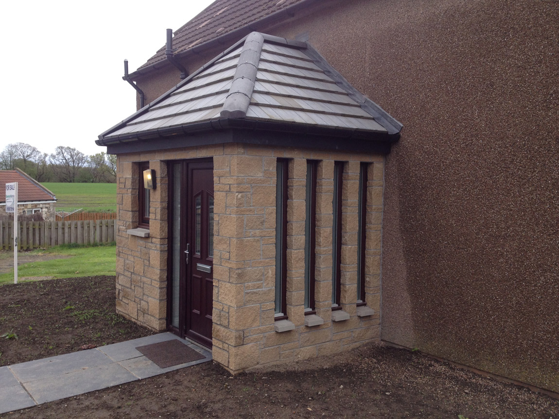 front entrance porch with wc facilities and feature glazed windows