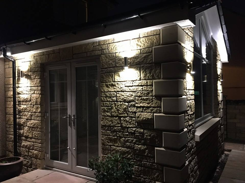 glass gable front design extension at night