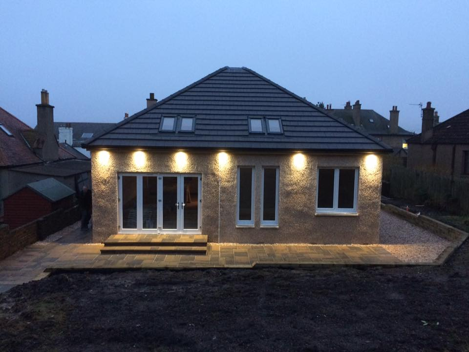 huge extension to rear of dwellinghouse with bi-fold doors