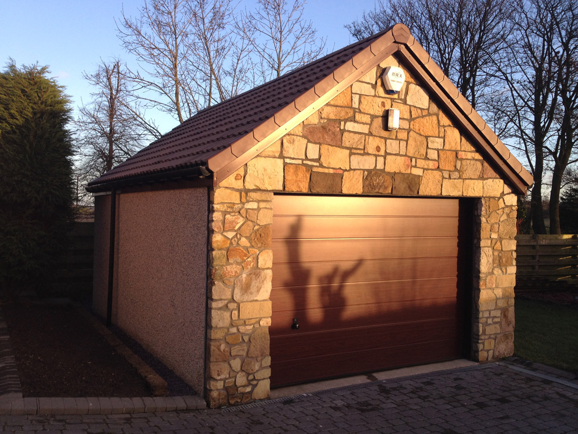 large single garage finished with stone gable