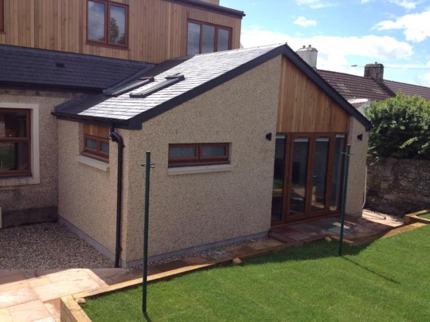 large single storey extension with cedar clad accents