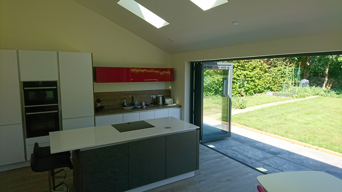 mono pitched extension with velux roof windows and bifold doors