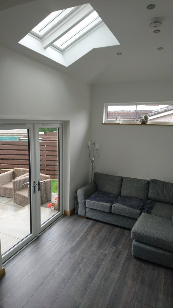 pitched ceiling and double velux over french doors