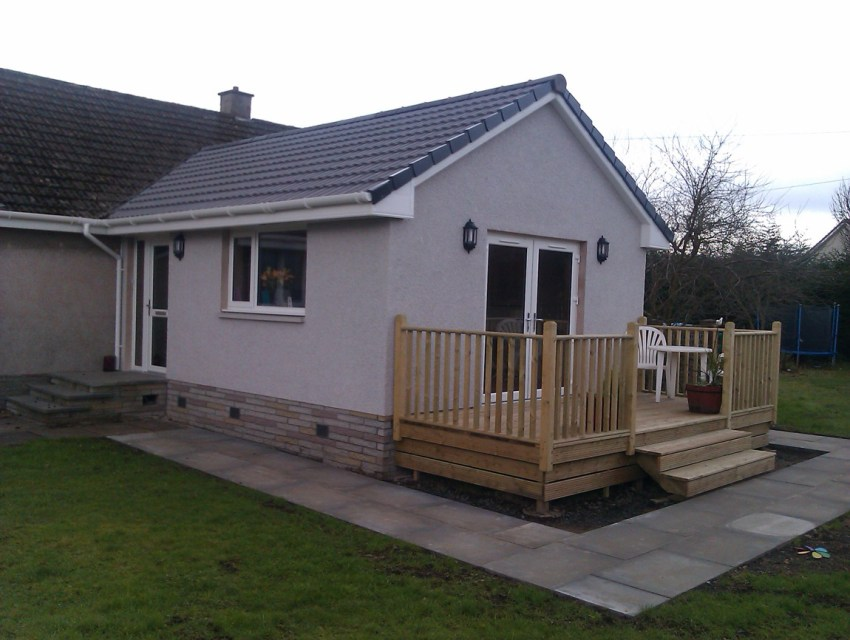 single storey extension to rear with timber decking