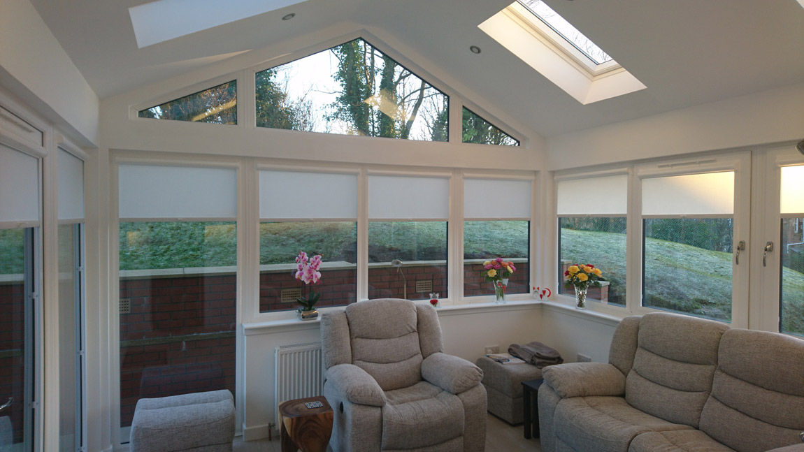 sunroom extension with velux roof windows and glass gable
