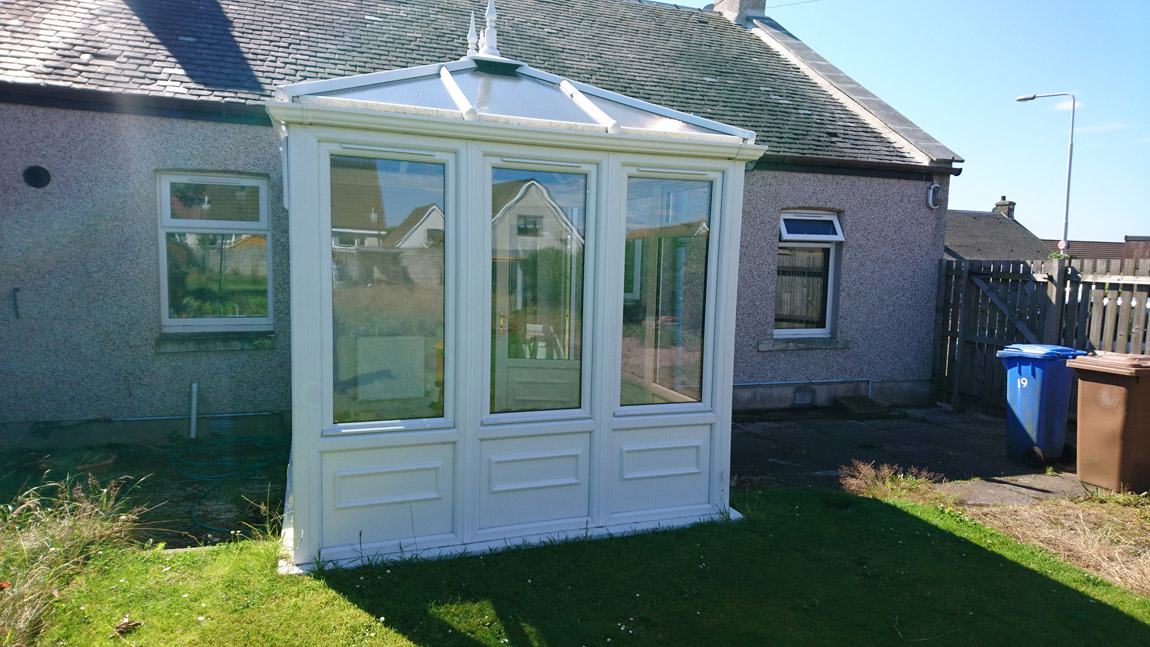 white pvcu edwardian style conservatory with decorative panels