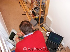 LAPTOP_Dad transfers software from the old controller to the newer one.