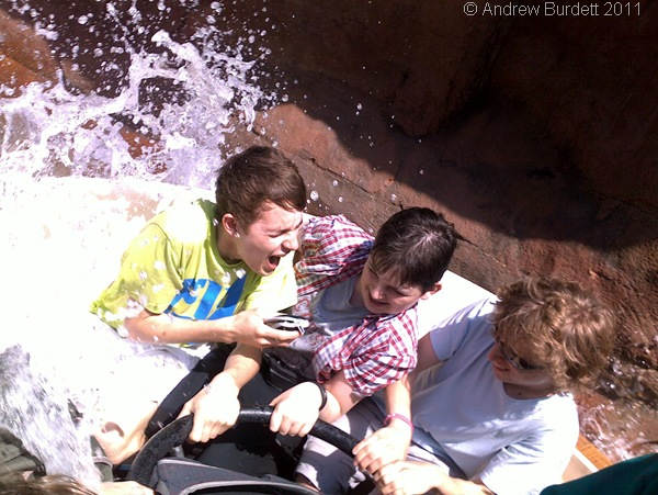 SPLASH DOWN_Jay Bricknell, Josh Raffles, and Ben de Souza get a soaking on the Grand Canyon Rapids ride, during Wednesday's theme-park visit.