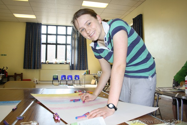 SMILES ALL ROUND_Harriet Burdett, 19, works on a part of the artwork for the Easter Day cross.