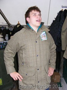 WHAT WHAT_Trying a tweed jacket for size.