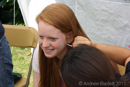 FLOWER POWER_Serena Tajima puts the finishing touches to her design on Rachel Beaumont's face.