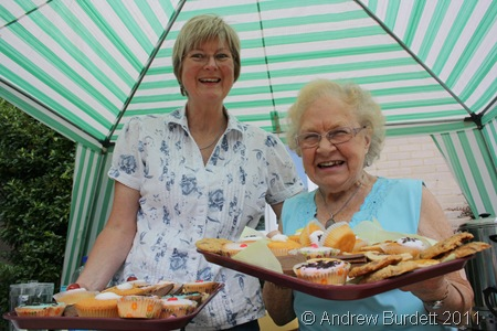 TRY ONE OF THESE_Lin Luff and Marion Brooke offer cakes under the tea gazebo.