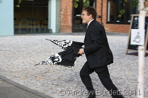 QUICK_Matthew returns brollies to guests who'd forgotten them. (2 of 4)