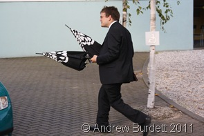 QUICK_Matthew returns brollies to guests who'd forgotten them. (3 of 4)