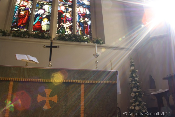 LIGHT FROM GOD_Flowers at the high-altar, with sunlight flooding the east of the church.