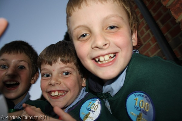 SMILING FACES_Furze Platt Cubs, with their centenary badges on their jumpers.