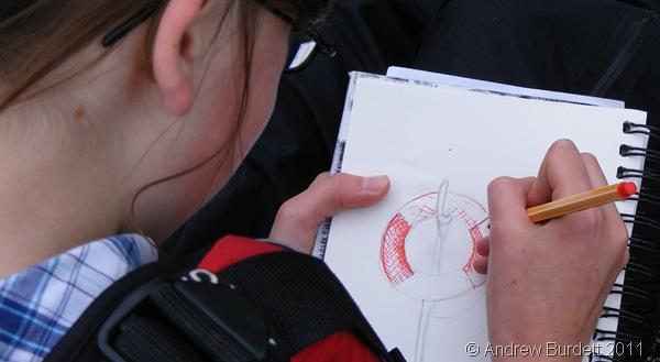 A NATURAL_Tilda Rose drawing the lifebuoy.