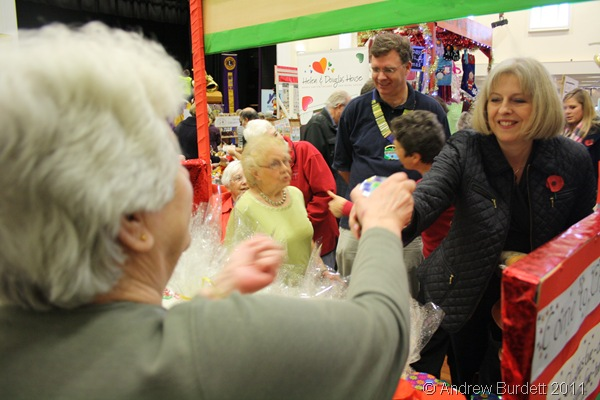 PLEASURE DOING BUSINESS_Home Secretary Theresa May buys produce from the St Luke's stall at the fair.