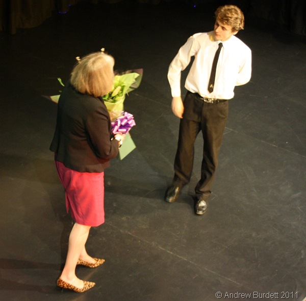 BRIEF ENCOUNTER_A student presenting Theresa May MP with flowers, after she opened the new Drama block. He then showed her to her seat, and began reciting Shakespeare.