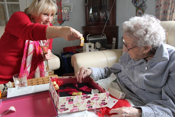 HELPING HAND_Kate (Dorothy's daughter) helped her mother unwrap her Christmas parcel from us.
