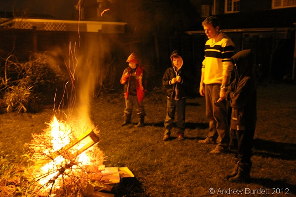 LOGS ON THE FIRE: Luke Darracott stands with younger congregation members as the bonfire burns. (IMG_1043)