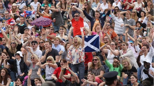 SHOW OF SUPPORT: The match - and weather - started off well for Murray, but fortunes soon changed. (_61439597_015277200-1)