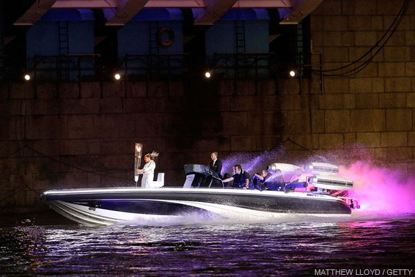 ZIPPING ALONG: The Torch travelled by speedboat up the Thames from City Hall where it had rested from lunchtime.