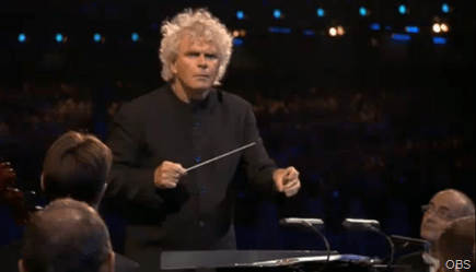 SHAKE RATTLE AND ROLL: Sir Simon Rattle giving Bean a wide berth.