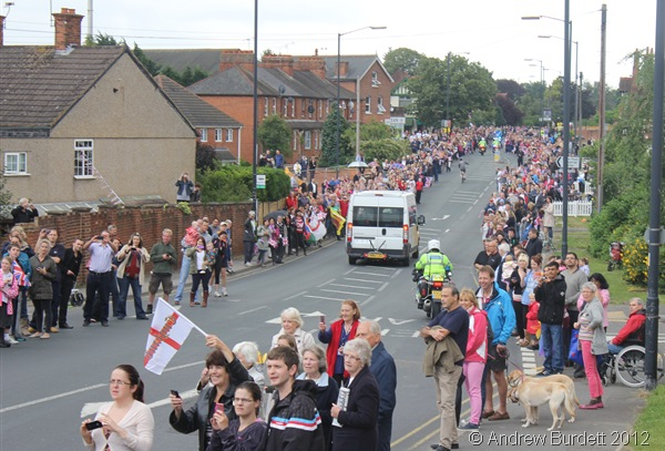 LINING THE ROUTE: Thousands of people descended on the the road to see the Torch pass. (IMG_8824_ARB)