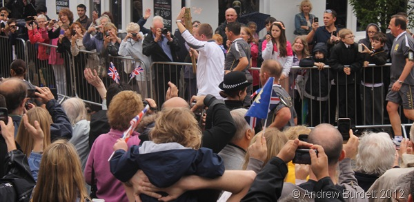 DOWN THE HIGH STREET: The Torch begins the end of its Maidenhead stint as it turns down the High Street. (IMG_8912_ARB)