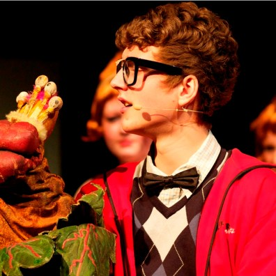 PUPPET SHOW: Seymour (Mark Janes) with the little version of the Audrey II. (IMG_3474_AlexMeade)