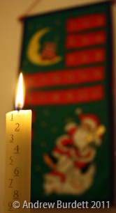 COUNTING DOWN TO CHRISTMAS: Our 2011 Advent candle shines bright. (IMG_6151)