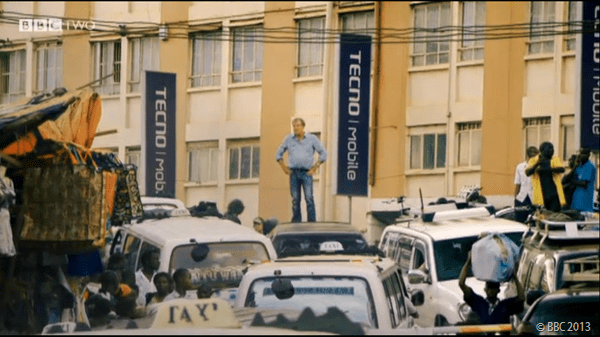 STANDING TALL: Jeremy Clarkson inspects the traffic he and his colleagues must pass through.