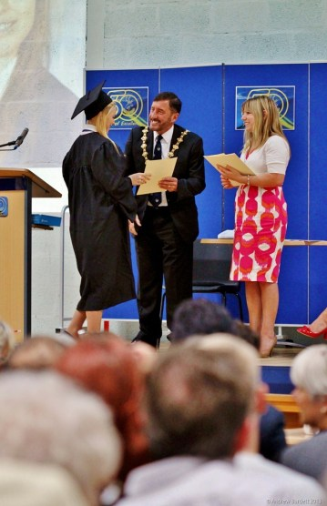 THE MAIN STAGE: A 'graduate' with Cllr Andrew Jenner and Assistant Headteacher Miss Morris.