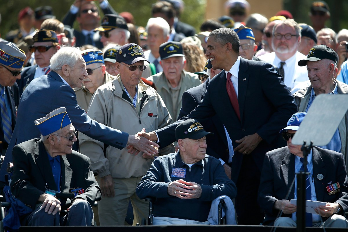 Barack Obama shakes hands with D-Day veterans.