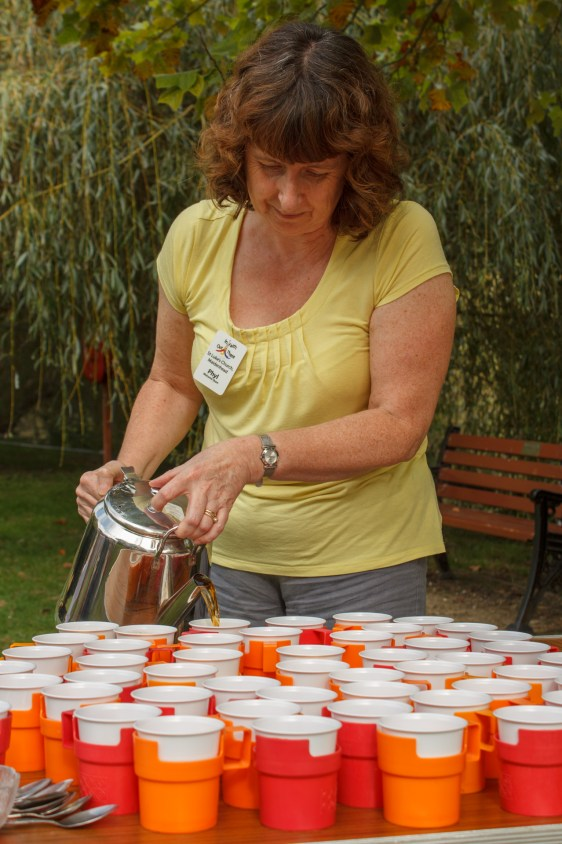 Phyl Sopp begins pouring tea for the thirsty pilgrims.