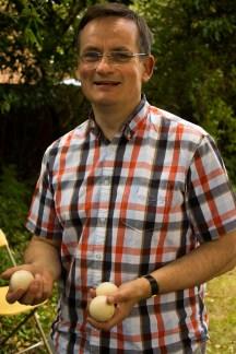 Richard Burdett prepares to take a shot on the coconut shy.