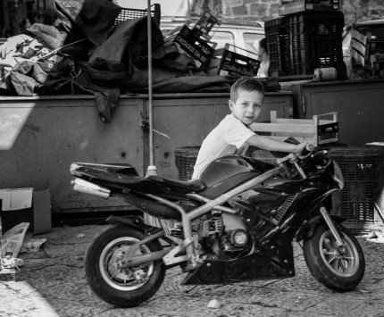Palermo children photographed by motorbike photographer Andrew Butler