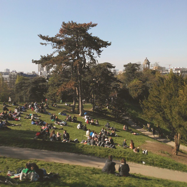People seating on lawns on a May afternoon