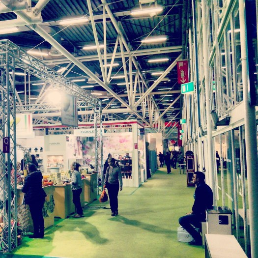 People walking along the booths inside a pavillion of Cosmoprof Beauty Show, Bologna, Italy