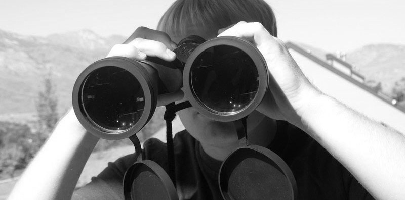 boy-looking-through-binoculars-1368989