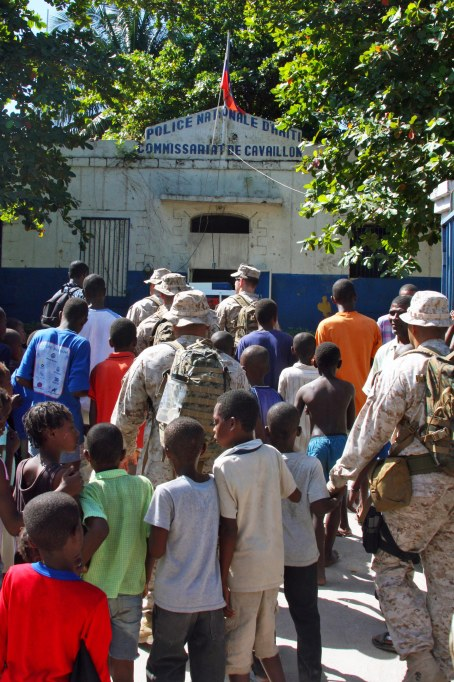 Marines and Sailors from the 24th Marine Expeditionary Unit and Nassau Amphibious Ready Group conduct a site survey in the town of Cavaillon, Haiti Jan 28. This group of Marines and Sailors were sent to assess a multitude of things including medical readiness, power supply, food and water availability, and infrastructure after the recent earthquake in Haiti. (US Marine Corps photo by Sgt Andrew J. Carlson)